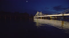 4K Night time view of the Albert Bridge at Chelsea Harbour, London - stock footage