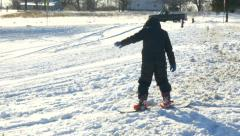 Young boy learning how to snow board Stock Footage