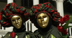 Close up of two venetian masks red and green Stock Footage