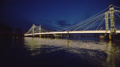 4K Night time view of the Albert Bridge at Chelsea Harbour, London Stock Footage
