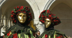 Two venetian masks red and green in front of Doge Palace Stock Footage