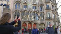 Tourist take a photo of  Gaudi building Stock Footage
