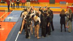 4K college girls gymnastics team in a huddle Stock Footage