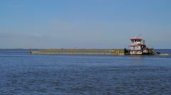 Pusher Tug with fuel barge near Port Arthur, Texas Stock Footage