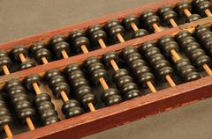 Chinese, horizontal picture of an ancient Chinese abacus - stock photo