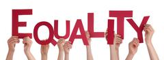 Many People Hands Holding Red Word Equality - stock photo
