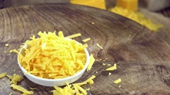Portion of grated Cheddar (not loopable) Stock Footage
