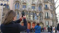 Tourist take a photo of a building Stock Footage