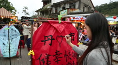 Asian woman see pass yellow train and smile in the festival lanterns, Taiwan-Dan Stock Footage