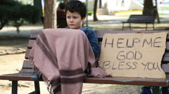 Homeless child begging in street - stock footage