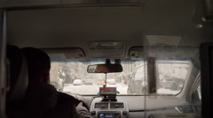 Taxicab driver driving winter snow interior taxicab meter rearview mirror 4K NYC Stock Footage