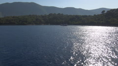 Sun reflected in the sea water. Island landscape shot from a boat. Holiday trip. Stock Footage