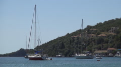 Sailboat in a touristic port. . Landscape with island harbor. Holiday view. Stock Footage