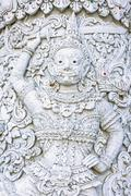 White demon guardian at Ming Mueang temple, Nan province, Thailand - stock photo