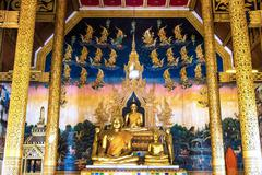 NAN PROVINCE, THAILAND - DEC28, 2014: Golden buddha statue at Sri Pan Ton tem Stock Photos