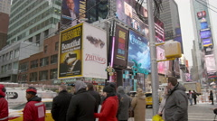 New Yorkers tourists crossing Times Square intersection winter slow 4K NYC Stock Footage