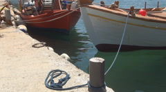Beautiful fishing boats anchored in a local port. Island Mediterranean holiday. - stock footage