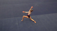 Slow motion of part of artistic dance portion of floor routine Stock Footage