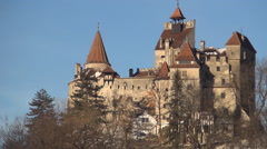 Transylvania land, Bran Castle, Dracula Legend. Winter view in a sunny day. - stock footage