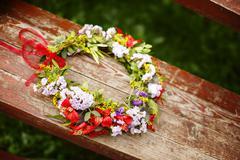 Flower wreath decoration on wood - stock photo