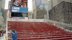 TKTS red stairs Times Square winter sanitation worker cleaning snowing 4K NYC - stock footage