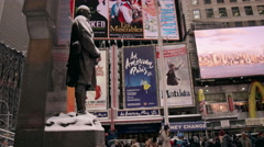 Father Duffy statue tilting tourists people line snowing winter Times Square NYC Stock Footage