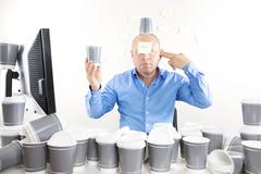 Businessman with coffee addiction Stock Photos