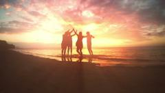 Friends celebrating on the beach. 4K footage. Broadcast quality. Stock Footage