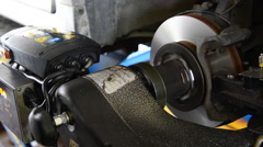 Machine turning car brake, Auto machine grinding the brakes car. - stock footage