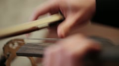 Playing strings of a Cello with fingers, close up Stock Footage