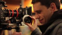 Focuspuller at work. Closeup, Filming commercial, behind the scene. Film product Stock Footage