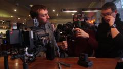 Stock Video Footage of The cameramen at work, Filming commercial, behind the scene