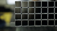 Factory worker takes a metal pipe off the shelf Stock Footage