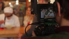 The cameraman looks at the monitor during shooting. Film production Stock Footage