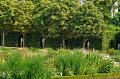 garden of Grand Trianon in Marie Antoinette estate - stock photo