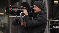 The cameraman shoots a movie on a big professional camera Stock Footage