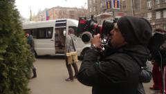 The cameraman shoots the scene of the movie. Film production - stock footage