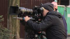 Cameraman with a camera in shooting the film. Film production - stock footage