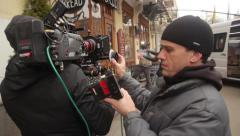 Focuspuller at work during filming. Film production Stock Footage