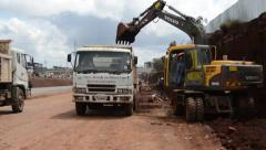 BACK-HOE-LOADING_Road Construction_Africa Stock Footage