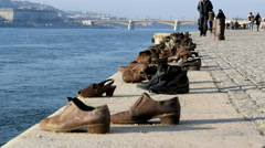 Shoes on the Danube Memorial looking towards Margaret Bridge, Budapest, Hungary Stock Footage