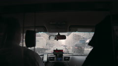 Taxi driver interior windshield meter front seat driving rainy raining 4K NYC Stock Footage