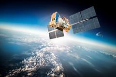 Space satellite over the planet earth Stock Photos