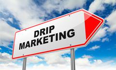 Stock Illustration of Drip Marketing on Red Road Sign