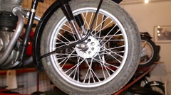 Old motorcycle, front wheel Stock Footage