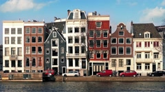 Car Passes Typical Dutch Houses By Canal Stock Footage