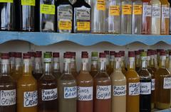 rum and punch in the Sainte Anne market in Martinique - stock photo