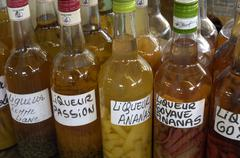 Rum and punch in the Sainte Anne market in Martinique Stock Photos
