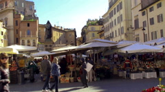 Daily market Campo de' Fiori with the statue of Giordano Bruno in the background Stock Footage