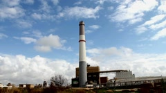 Small power plant using gas on blue sky and white clouds background. - stock footage